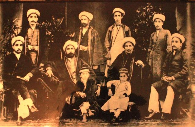 Seated from the left: Mohd. Qasim (Aga Jan), Abdul Hussain, Abdul Hussain, Aga Ali Asker and Aga Abdullah. Standing first from left is Aga Abbas Ali. Image courtesy: Mirza Habib Aga Shirazi.